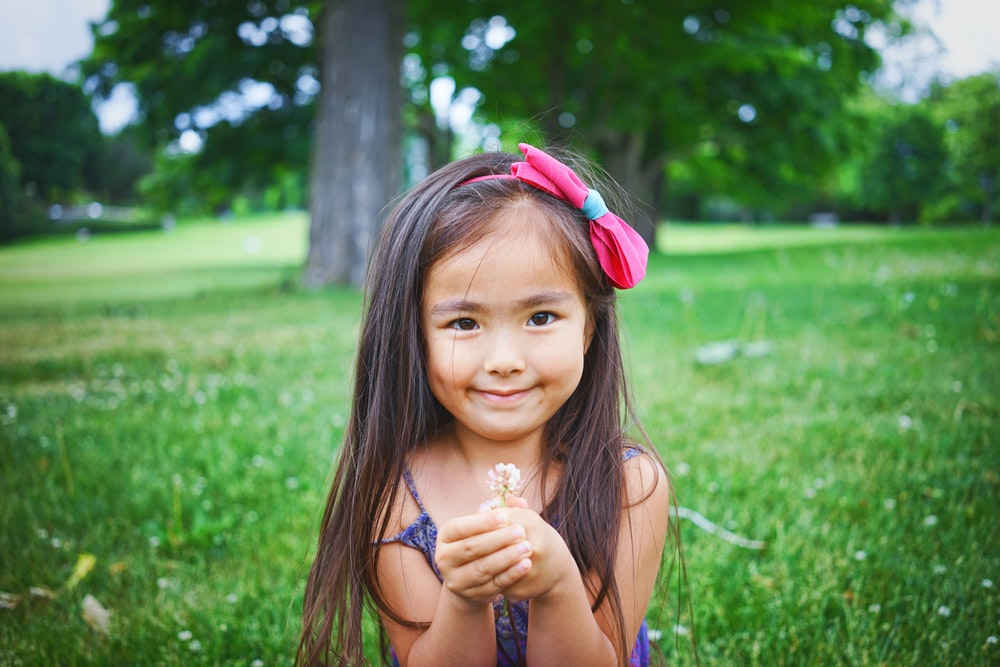 Little girl holding flower