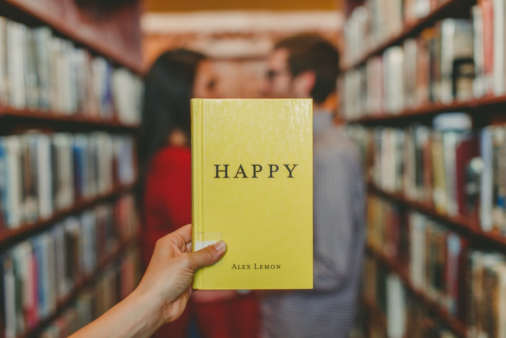 Yellow book named happy